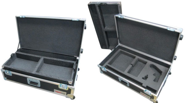 We see three black, opened road cases with visible foam inserts sitting against a white backdrop.
