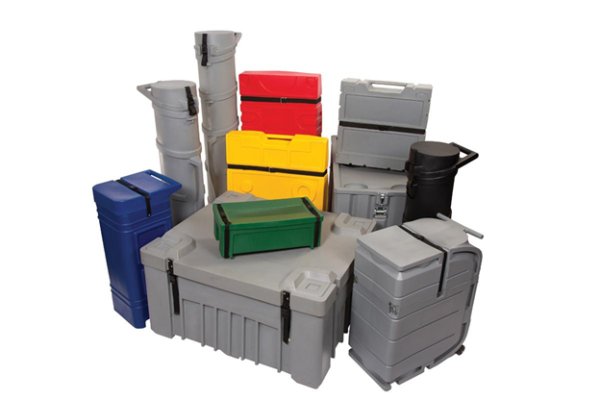Against a white backdrop, we see a pile of grey, green, blue, yellow, and red roto-molded trade show shipping cases.