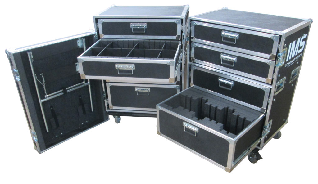 Three black workbox shipping cases sit against a white background with their drawers extended and doors open.